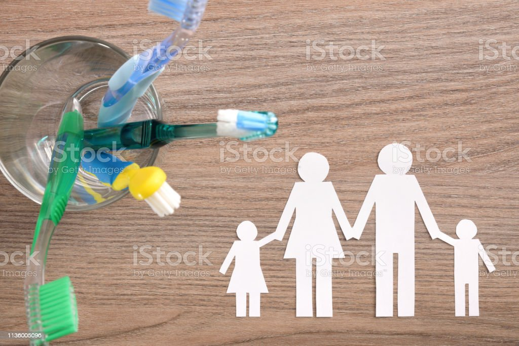 Concept of teeth cleaning at home of the whole family stock photo