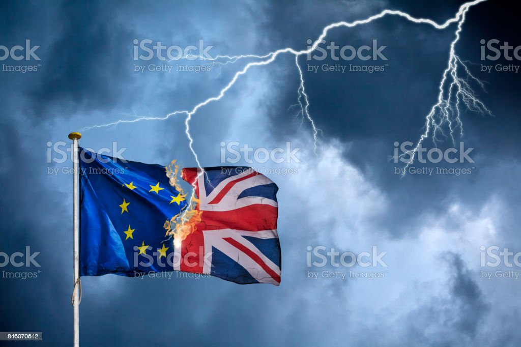 Concept of the British Brexit with the English flag struck by lightning stock photo