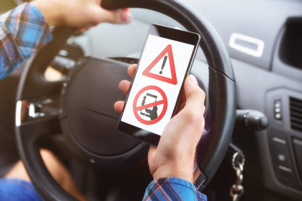 concept of the danger of the use of telephone driving - detraction stock pictures, royalty-free photos & images