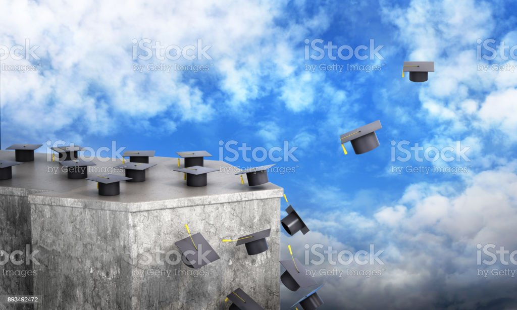 concept of the road into an independent life. The loss of success and limited opportunities, a career after graduation. Graduation hats fall from the rock and fly down stock photo