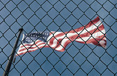 Concept of United States of America closed borders with flag and wire fence. USA immigration and homeland security. American dream concept, not accessible and hard to reach.