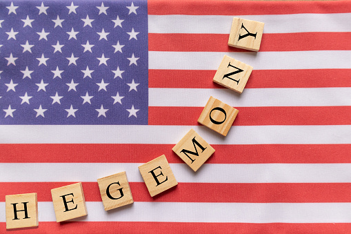 istock Concept of US hegemony, Hegemony in wooden block letters on US flag 1160516921