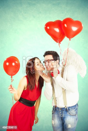 istock Concept of Valentine's Day with red heart-shaped balloons 466289615
