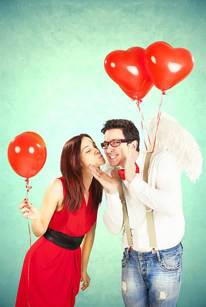 divertente san valentino - brunette woman eyeglasses kiss man foto e immagini stock