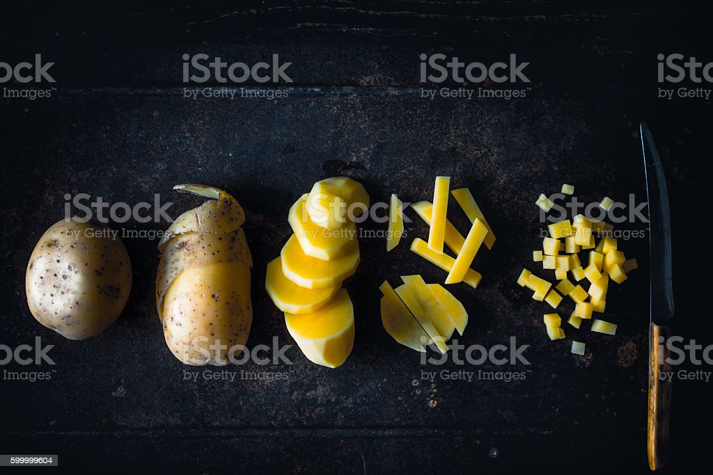 Concept of various stages of cutting raw potatoes top view – Foto