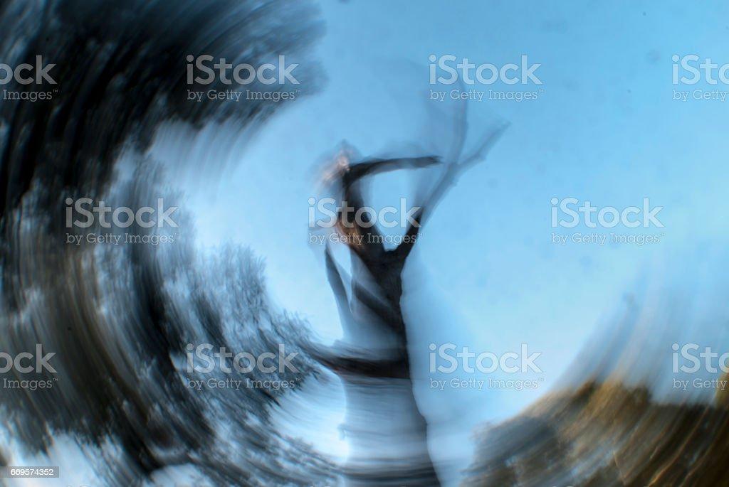 Concept of vertigo with spiral image of a tree stock photo