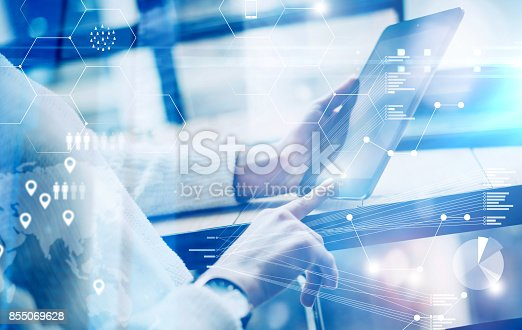 istock Concept of virtual screen,digital connection icon and graph interfaces.Young businesswoman using modern mobile tablet while sitting at sunny office.Blurred background. 855069628