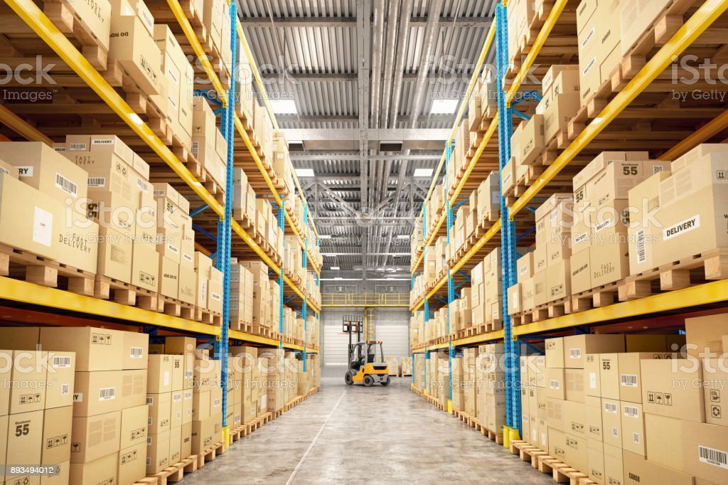 Concept of warehouse. The forklift between rows in the big warehouse stock photo