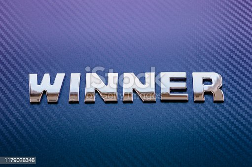 istock Concept of winning a motor race. Letters on carbon fiber background. 1179026346
