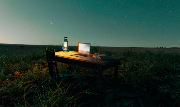 Concept of working from home in a remote location at night stock photo