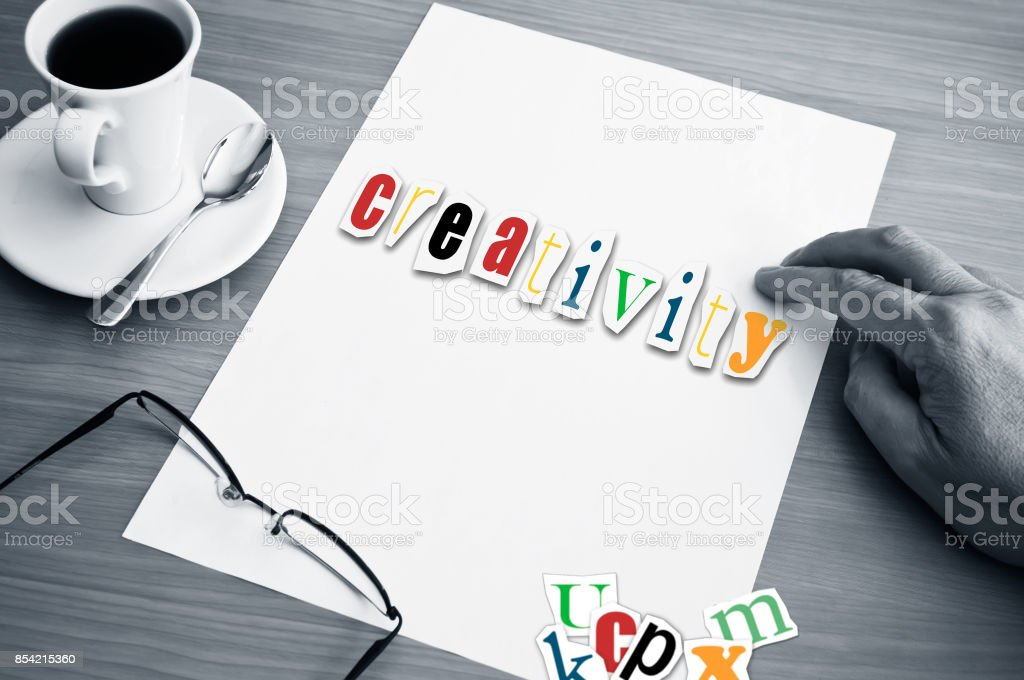 concept office cup of coffee and word creativity stock photo