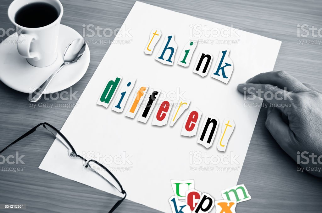 concept office cup of coffee and word think different stock photo