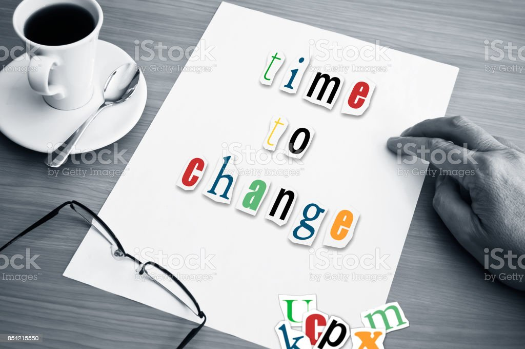 concept office cup of coffee and word time to change on white page stock photo