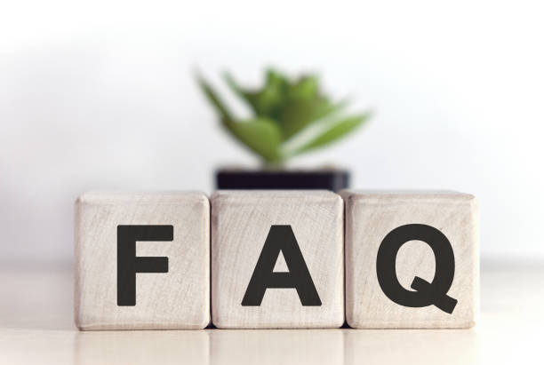 FAQ concept on wooden cubes and flower in a pot in the background FAQ concept on wooden cubes and flower in a pot in the background faq stock pictures, royalty-free photos & images