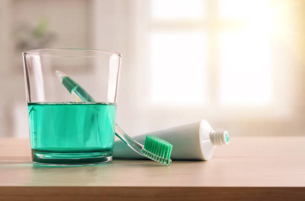 Concept oral hygiene on wood table in bathroom at home stock photo