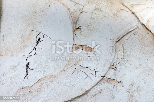 istock Concept: painted on the cave wall, ancient people hunt animal buffalo with a spear 688282446