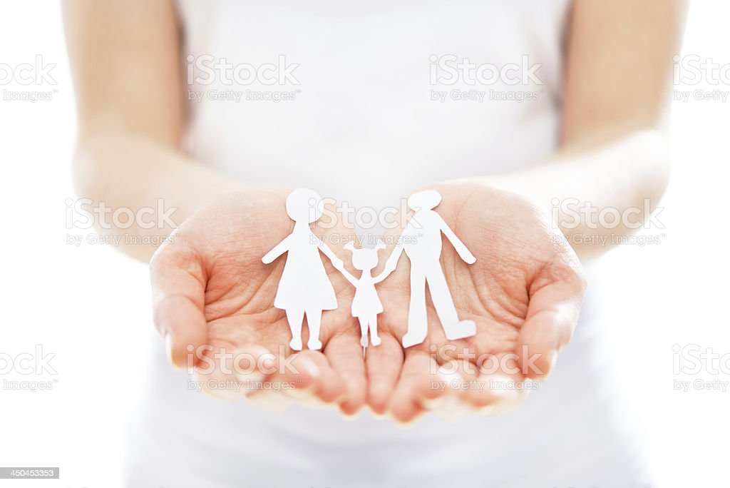 concept. paper figures of family in hands royalty-free stock photo