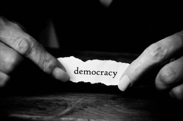 concept paper in hands - democraty - демократия стоковые фото и изображения