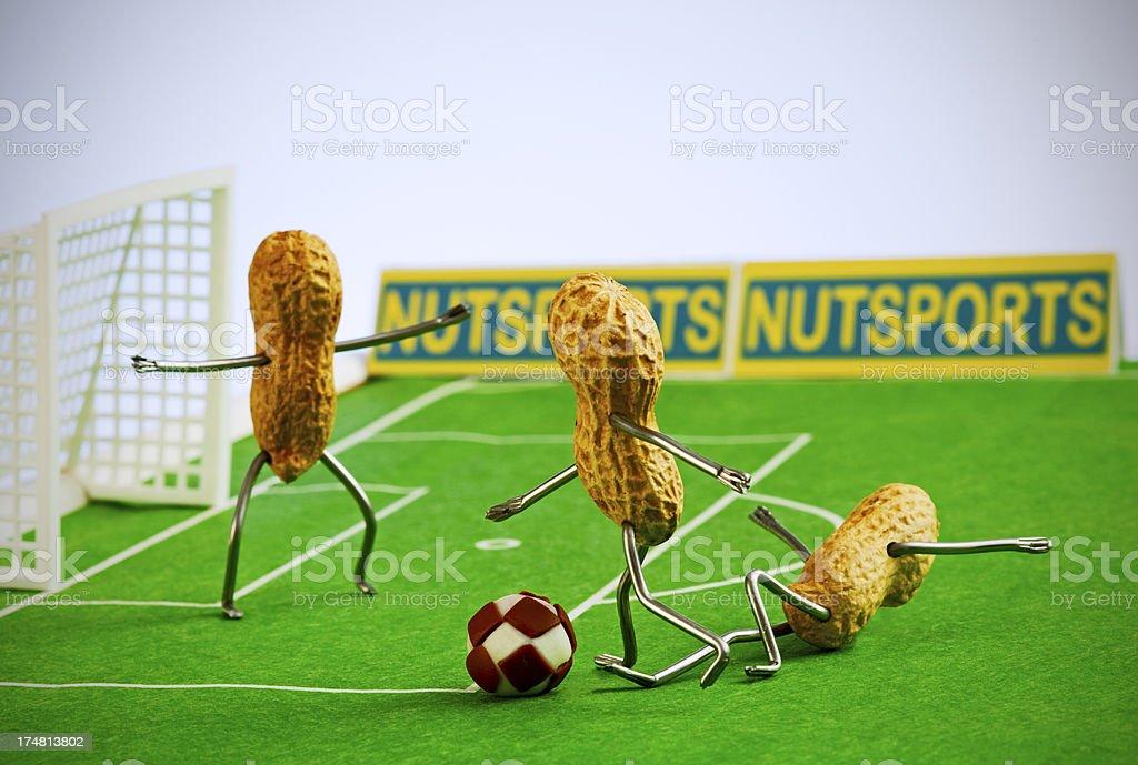 Concept peanutman- Football match stock photo