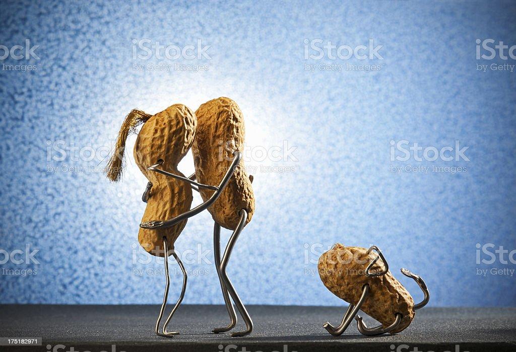 Concept peanutman- Kissing couple stock photo