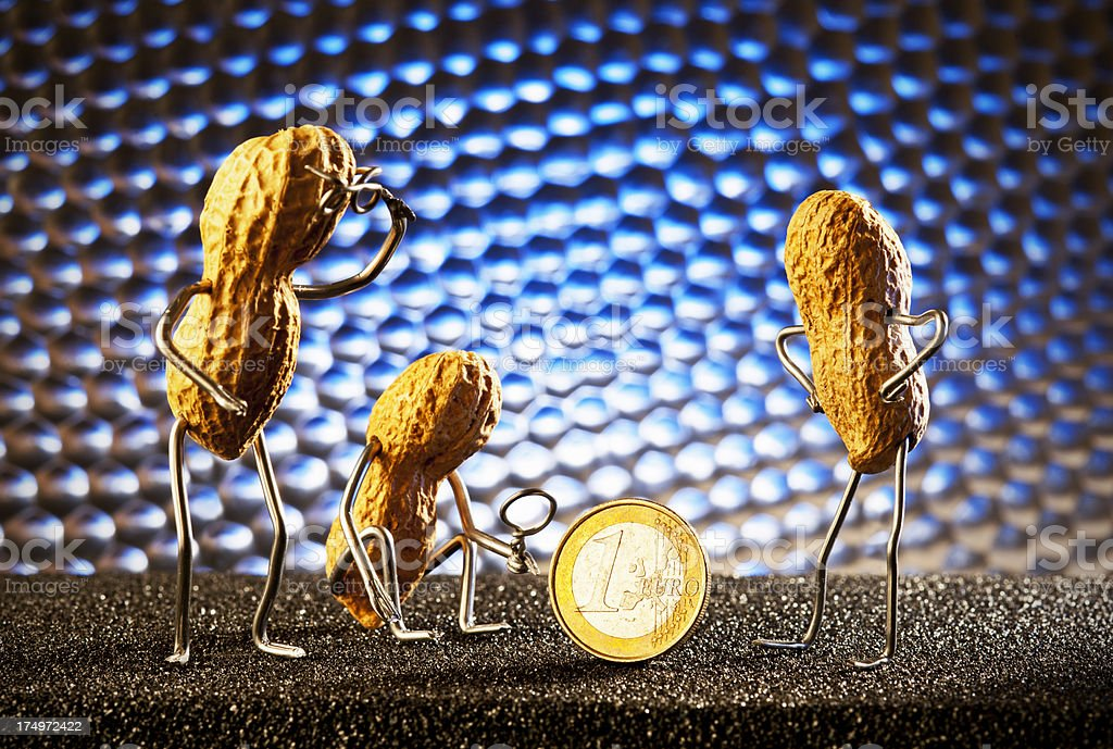 Concept peanutmen- Euro Coin inspectors stock photo