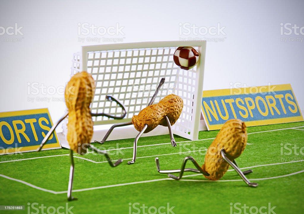 Concept peanutmen - Football goal stock photo
