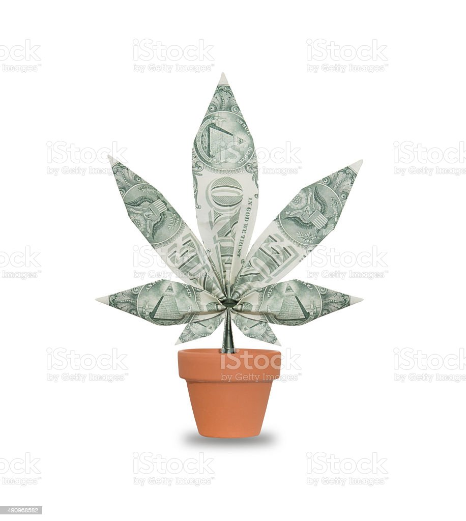 Concept photograph of cannabis leaf made of US dollar bills​​​ foto