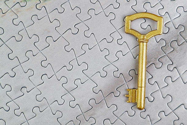 Concept picture golden key to the puzzle. Close-up. stock photo