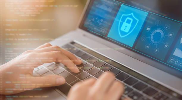 Concept protection cyber security, hands press computer laptop keyboard and lock icon with digital code on virtual screen. stock photo