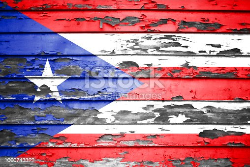 Concept Puerto Rico flag on cracked and paint peeling off background