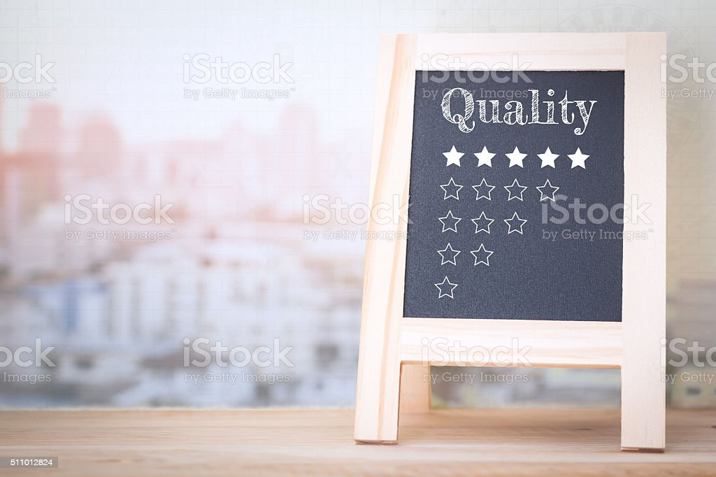 Concept Quality message on wood boards. stock photo