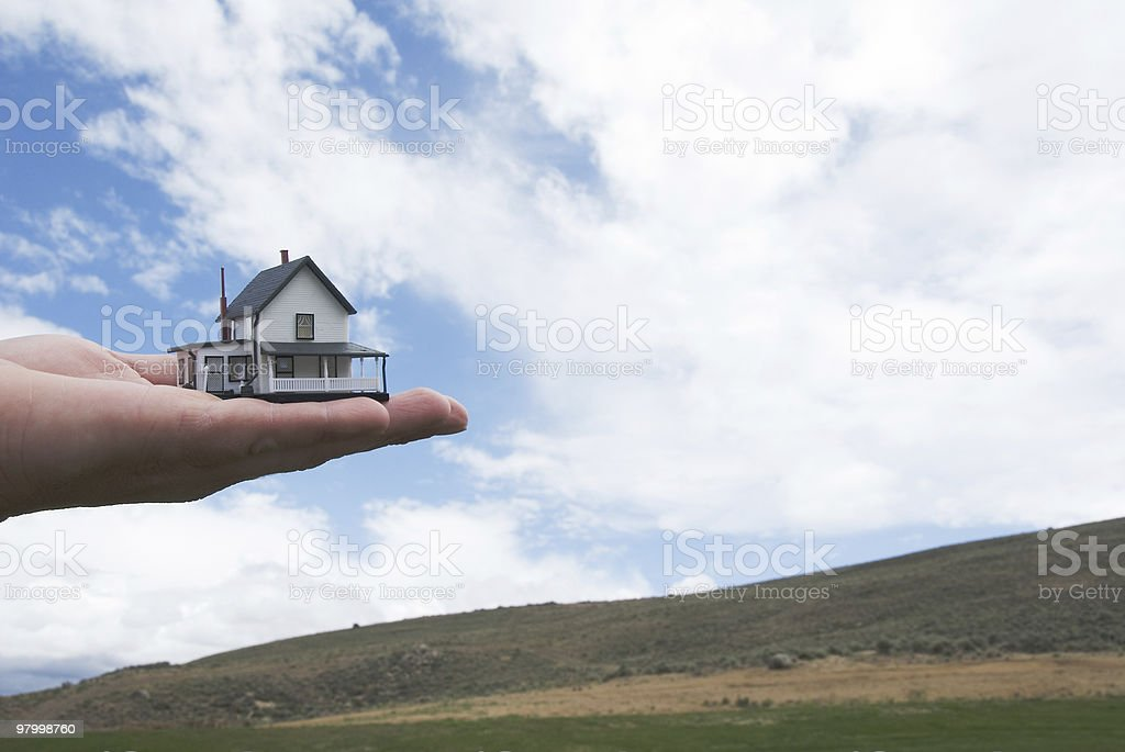 Concept - Real Estate: Hand holding a house royalty-free stock photo