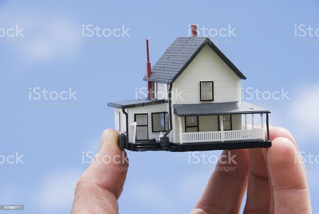 Concept - Real Estate: Hand holding a house royalty free stockfoto