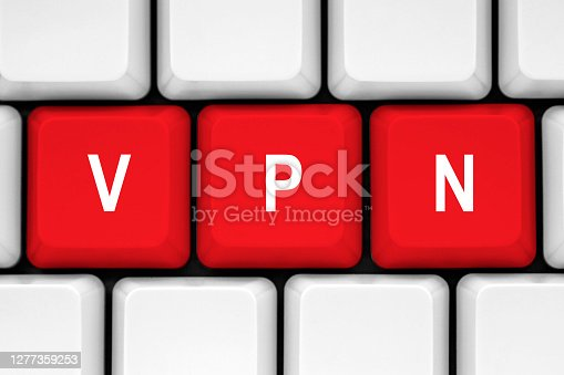 VPN Concept, Red button on white keyboard.