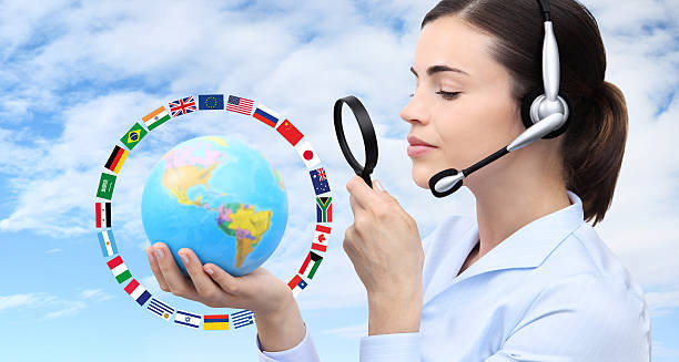 concept search, woman with headset, globe, flags and magnifying glass - tradução - fotografias e filmes do acervo