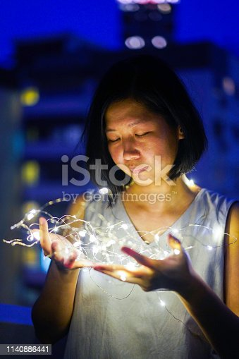 istock Concept Shoot of an Asian Girl embracing artificial intelligence 1140886441