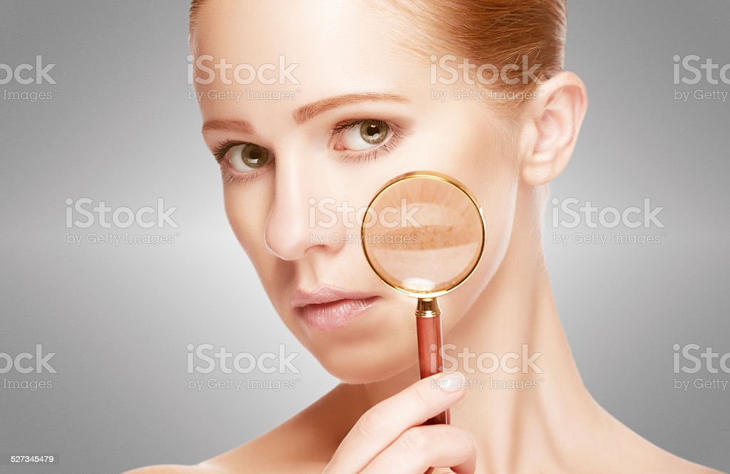 concept skincare. Skin of woman with magnifier stock photo