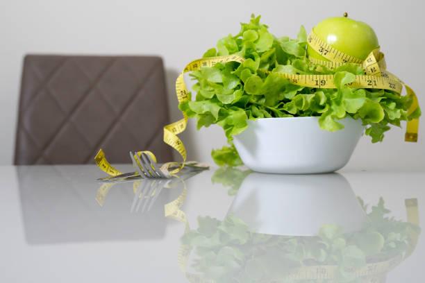 concept slimming diet fresh vegetables on white background stock photo