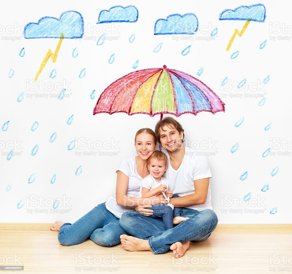 concept: social protection of family. family took refuge from  m stock photo