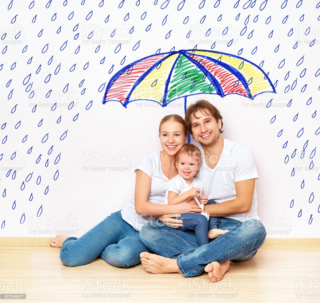 concept: social protection of family. family took refuge  under umbrella stock photo