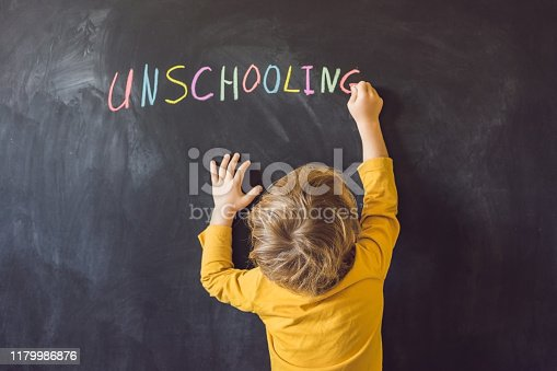istock Concept Unschooling Home Learning Back To School Color Chalk on Black Blackboard Background in Row Top View Flat Lay 1179986876