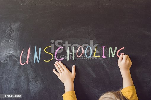 istock Concept Unschooling Home Learning Back To School Color Chalk on Black Blackboard Background in Row Top View Flat Lay 1179986889
