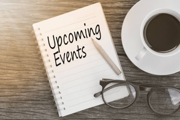 concept upcoming events message on notebook with glasses, pencil and coffee cup on wooden table. - event stock pictures, royalty-free photos & images