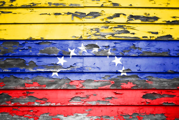 concept venezuela flag on cracked and paint peeling off background - venezuela stock photos and pictures