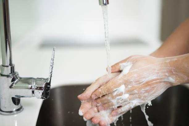 concept washing hands with soap - lavarsi le mani foto e immagini stock