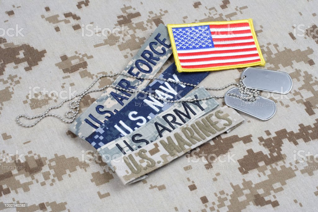 US MILITARY concept with branch tapes and dog tags on camouflage uniform US MILITARY concept with branch tapes and dog tags on camouflage uniform background Afghanistan Stock Photo