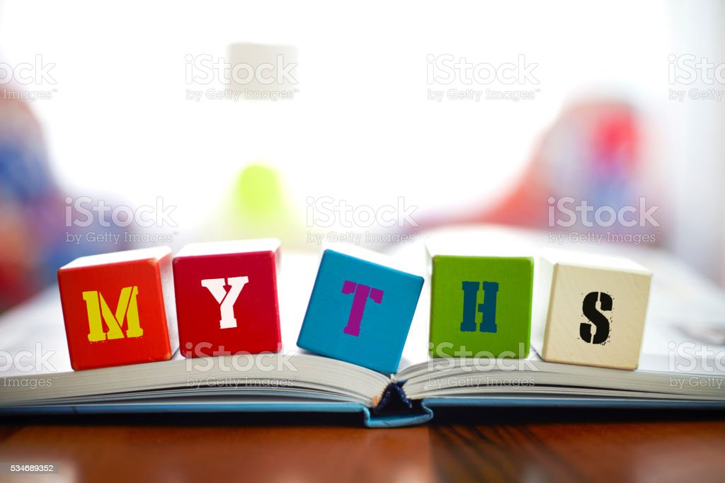 MYTHS Concept with building blocks on book stock photo