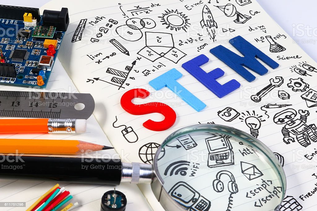 STEM concept with drawing background. Magnifying glass over education background. - foto de stock