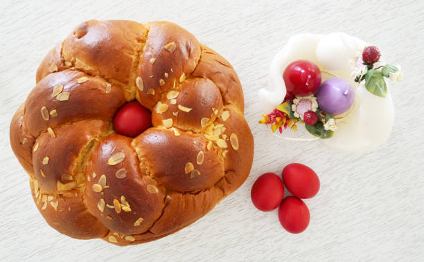 concept with easter bread ,candles and eggs - greek easter stock photos and pictures