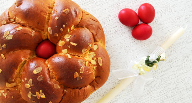 concept with easter bread ,easter candle and eggs - greek easter stock photos and pictures